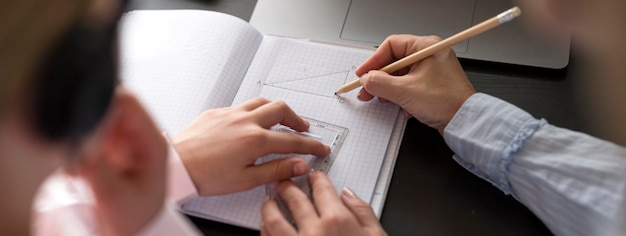 Woman and girl taking notes Free Photo