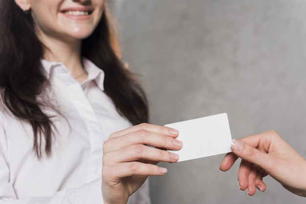 Woman giving business card to potential employee Free Photo