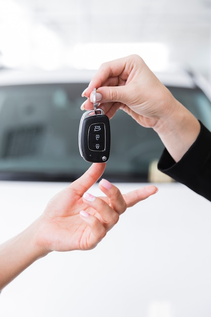 Woman giving keys to another woman Free Photo