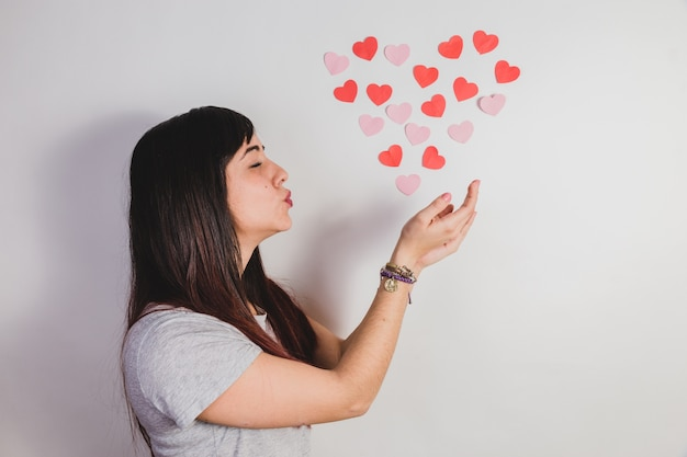 Woman giving a kiss to hearts Free Photo