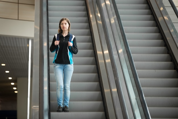 Woman Going Down Escalator Photo  Free Download-5052