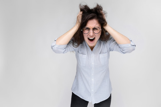 Woman grabbed her head and shouted. Premium Photo