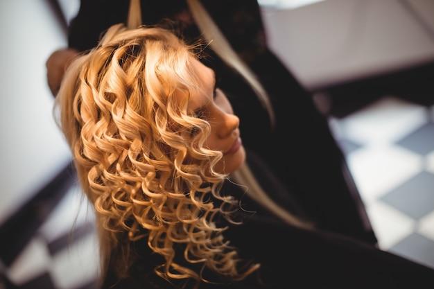 Woman in hair salon Free Photo