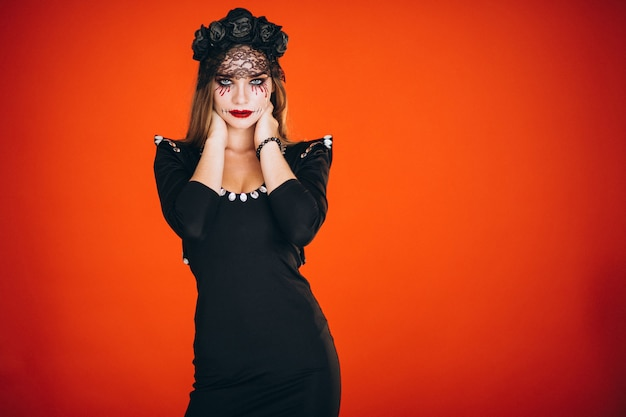 Woman in a halloween costume Free Photo