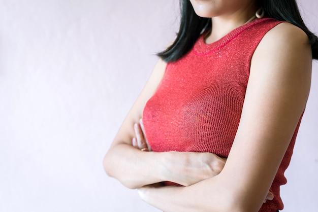 Woman hand cross her arm on breast Premium Photo