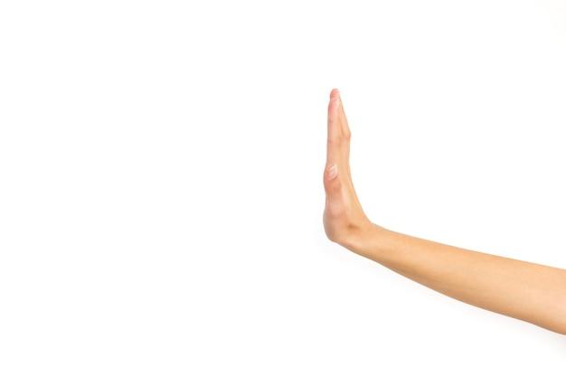Рука женщины делает знак остановки, изолированные на белом фоне с копией пространства Premium Фотографии