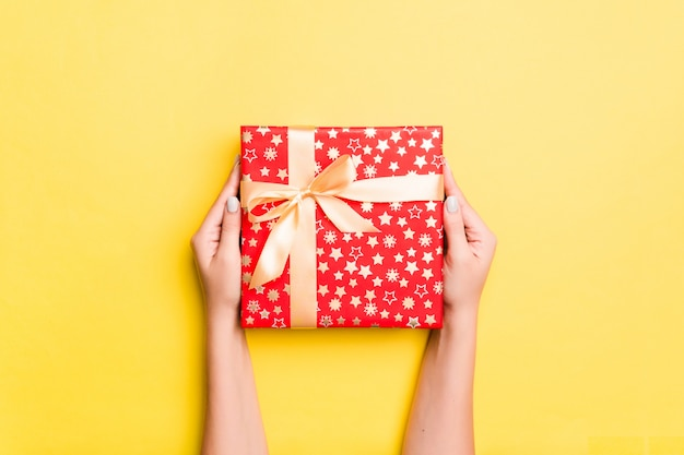 Woman hand give valentine gift box, top view Premium Photo