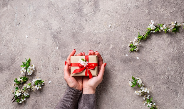 Woman hand hold gifts boxes. Premium Photo