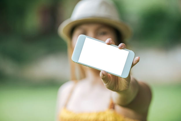 Woman hand holding cellphone, smartphone with white screen Free Photo