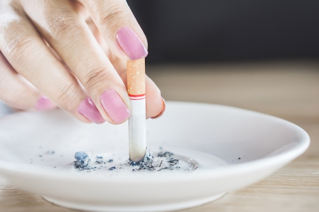 Woman hand holding cigarette stop smoking Premium Photo