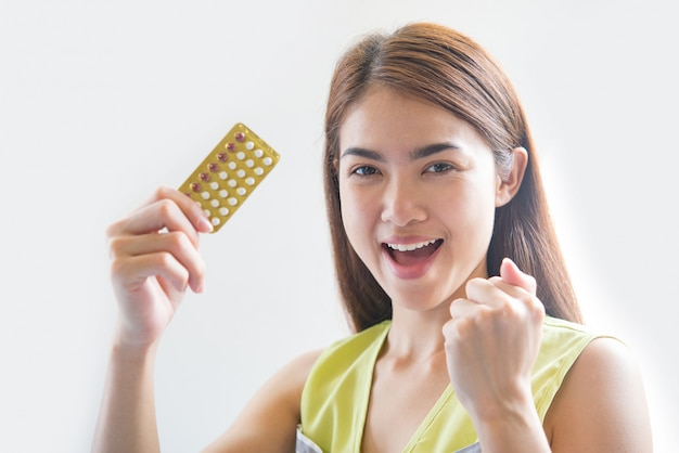 Woman hand holding a contraceptive panel prevent pregnancy Free Photo