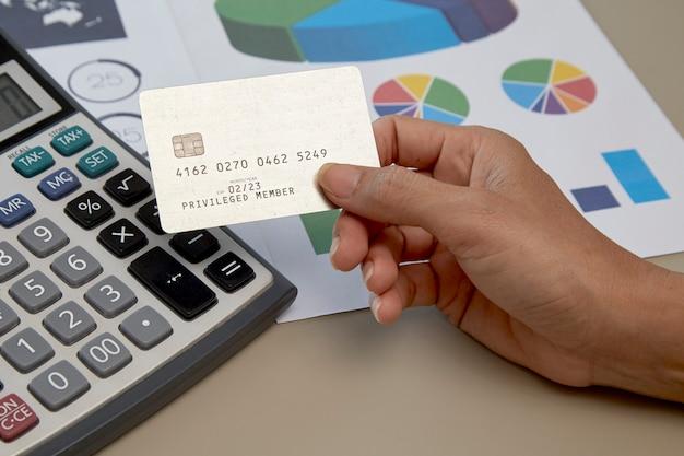 Woman hand holding credit card Premium Photo