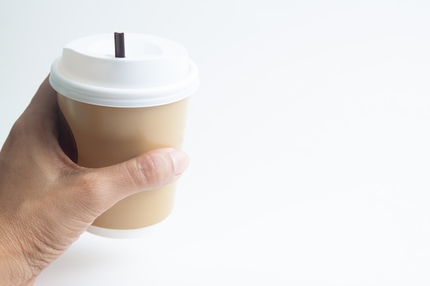 Woman hand holding a cup of hot coffee with copy space Premium Photo