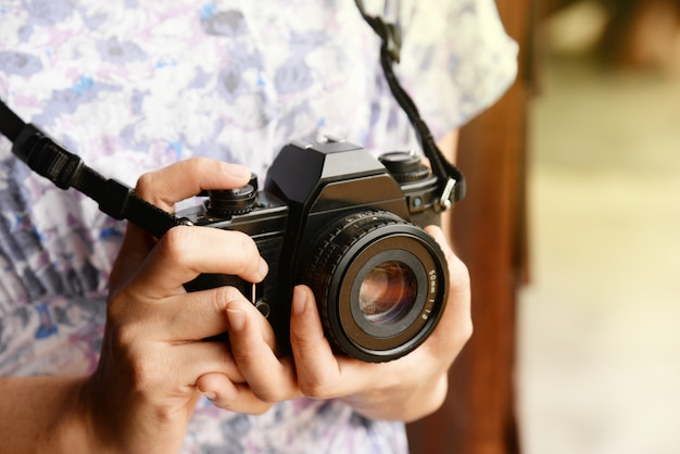 Woman hand holding retro camera close-up with copy space Premium Photo