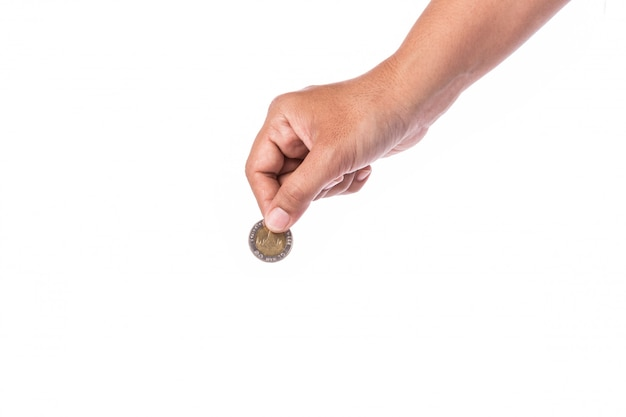 Woman hand holding thai coin (baht). Premium Photo