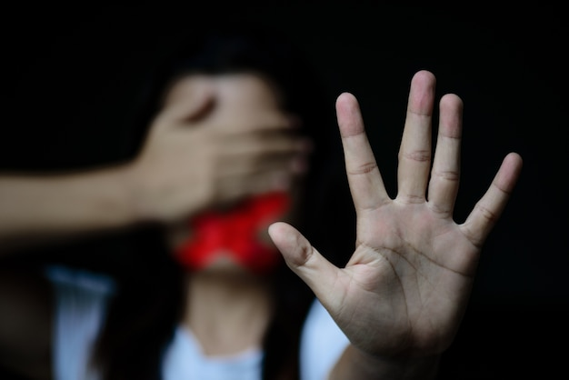 Woman hand sign for stop abusing violence, another hand close eyes Premium Photo