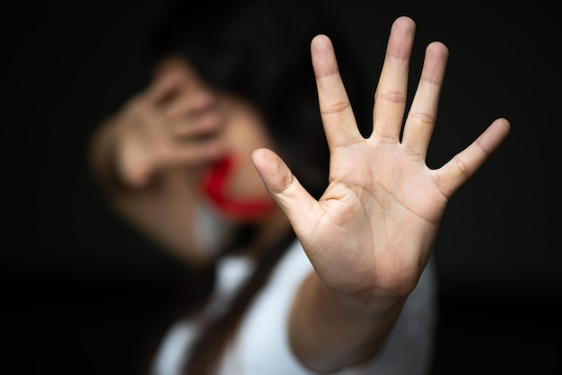 Woman hand sign for stop, abusing violence. human rights day concept. Premium Photo