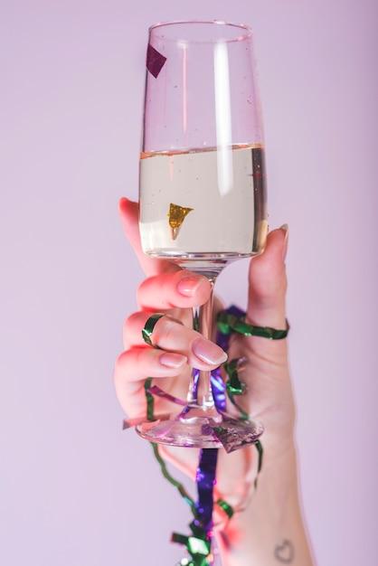 Woman hand toasting champagne glass Free Photo