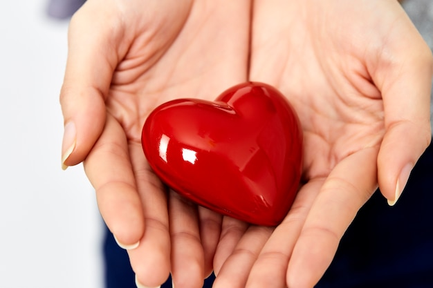 Woman hands giving heart love and sharing concept Premium Photo