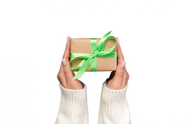 Woman hands holding gift wrapped and decorated Premium Photo