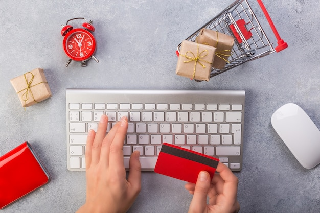 Woman hands ordering gifts online, paying by credit card Premium Photo