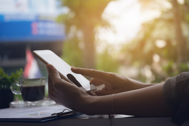 Woman hands using smart phone for wprk in coffe shop Premium Photo