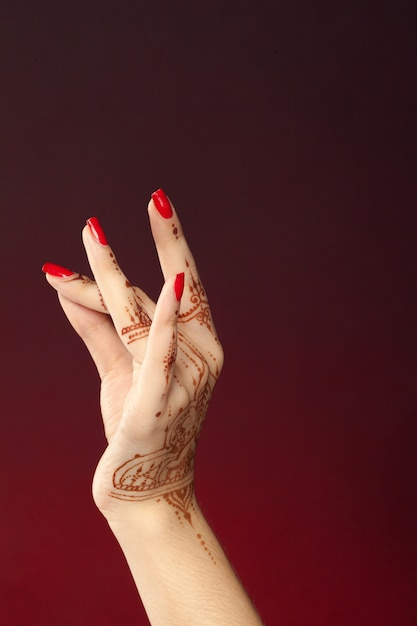 Woman hands with mehndi Premium Photo