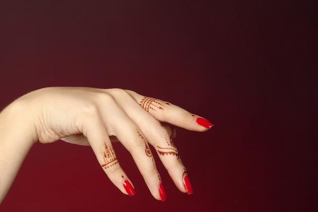 Woman hands with mehndi Premium Photo