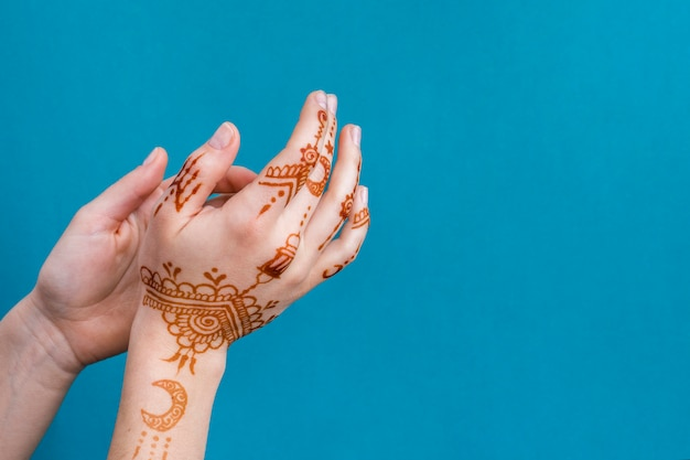 Woman hands with wonderful mehndi Free Photo