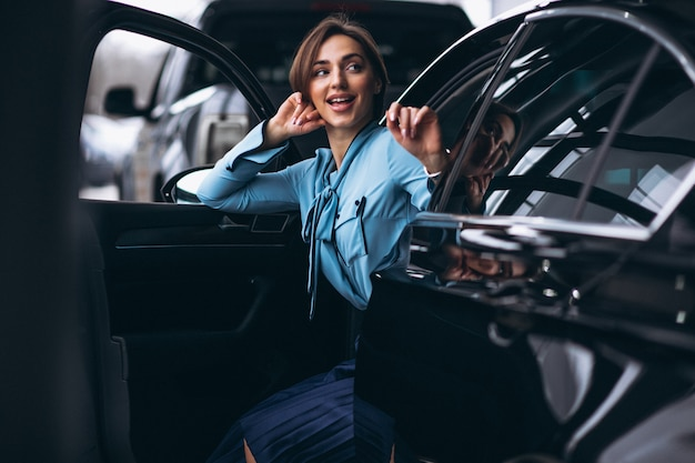 Woman happy buying a car Free Photo