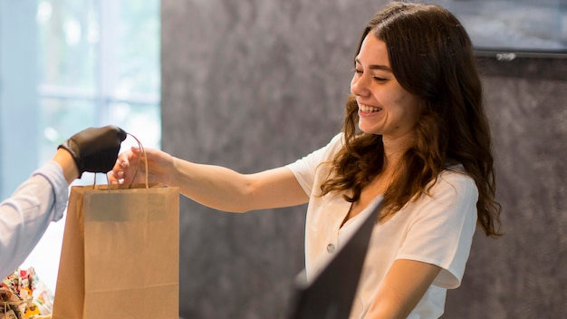 Woman happy to shop organic products Free Photo