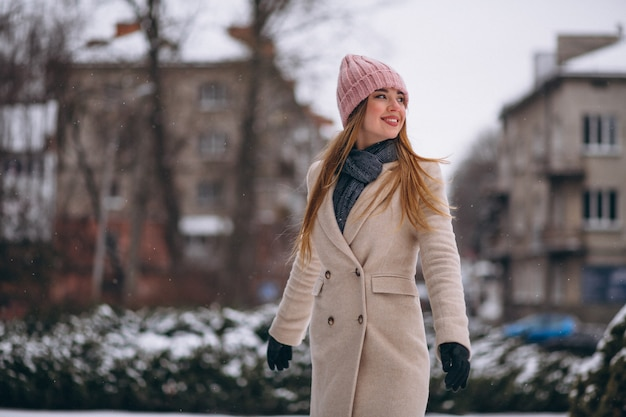 Woman happy in a winter park Free Photo