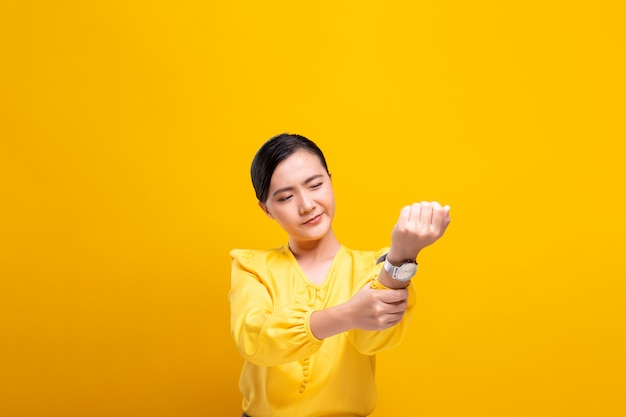 Woman has body pain isolated over wall Premium Photo