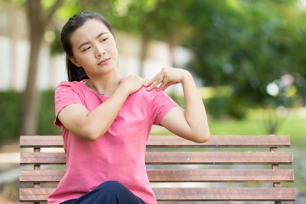Woman has body pain Premium Photo