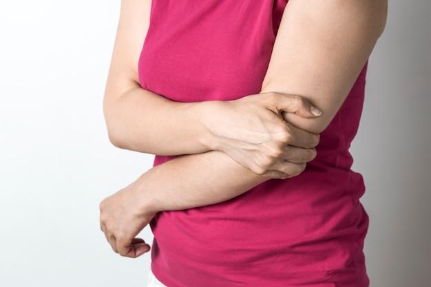 A woman has an elbow pain. Premium Photo