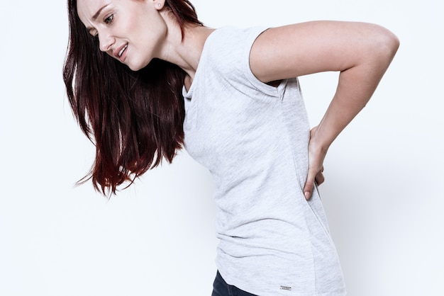 Woman has a pain in her back Premium Photo