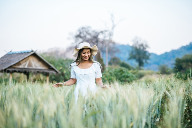 Woman in the hat happiness in the nature Free Photo