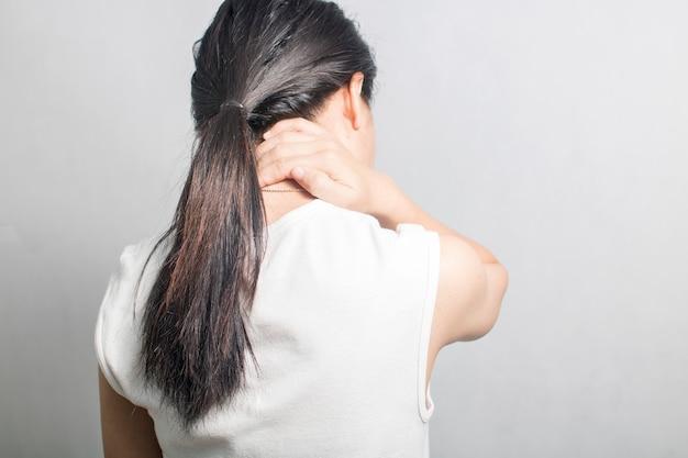 Woman have neck ache and pain Premium Photo