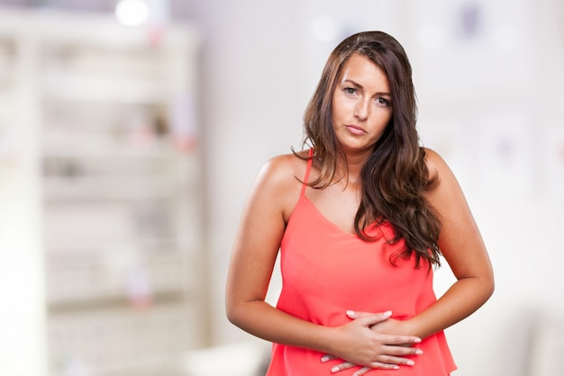 Woman having a stomach ache Free Photo
