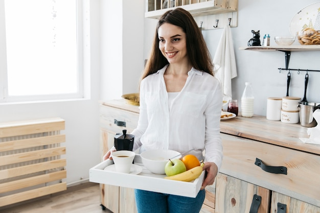 Woman having breakfast at the kitchen Free Photo