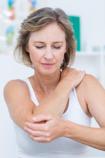 Woman having elbow pain Premium Photo