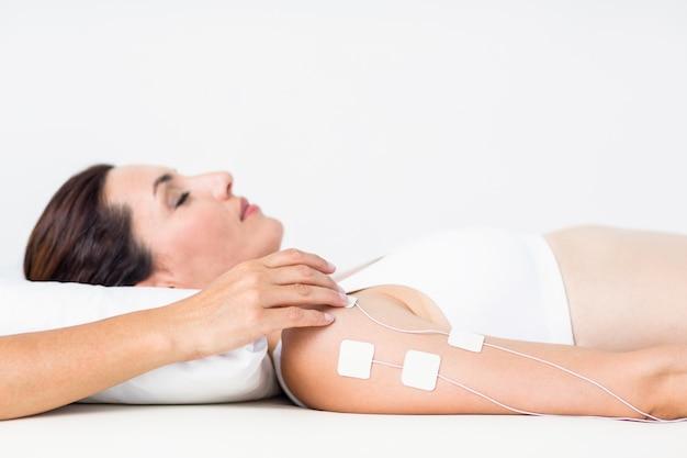 Woman having electrotherapy Premium Photo