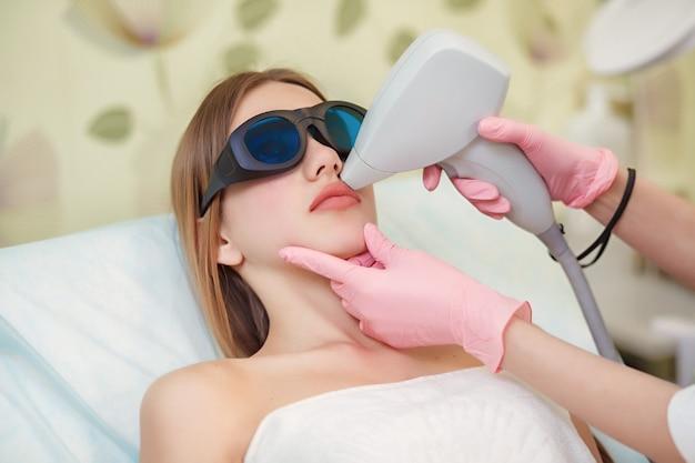 Woman having facial hair removal laser Premium Photo