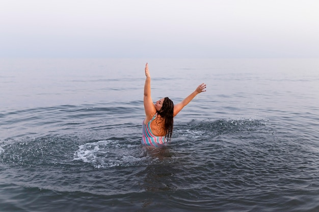 Woman having fun in the water at the beach Free Photo