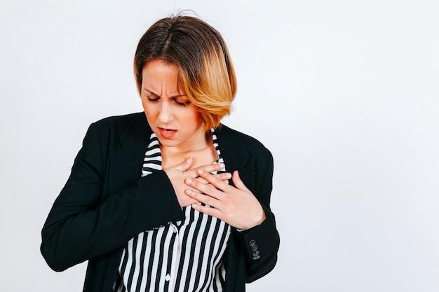 Woman having heart attack Free Photo