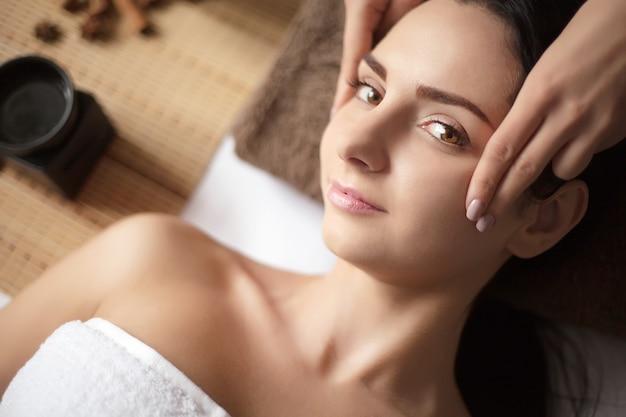 Woman having a massage in a spa Premium Photo