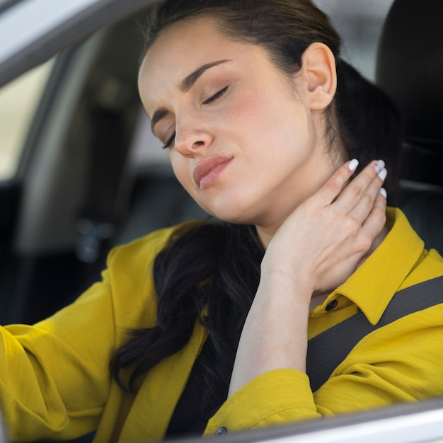 Woman having neck pain from the driving Free Photo