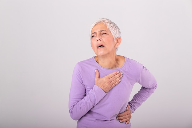 Woman having a pain in the heart area. heart attack. painful chest. health care, medical concept. high resolution. woman having heart attack at home Premium Photo