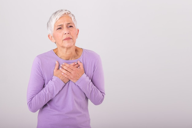 Woman having a pain in the heart area. heart attack. painful chest. health care, medical concept. high resolution. Premium Photo