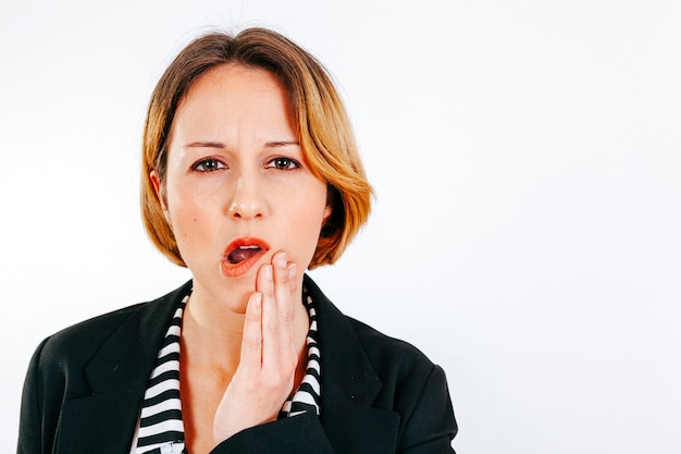 Woman having toothache looking at camera Free Photo
